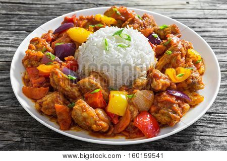 Rice With Sweet And Sour Fried Pork Chunks With Vegetables