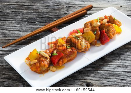 Sweet And Sour Fried Pork Chunks With Vegetables And Peanuts
