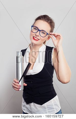 Smiling Woman Barber or Hairdresser with Hairspray and Comb