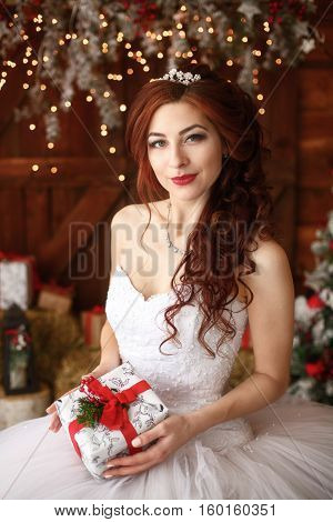 Christmas wedding. Young happy bride with gft. Marriage concept