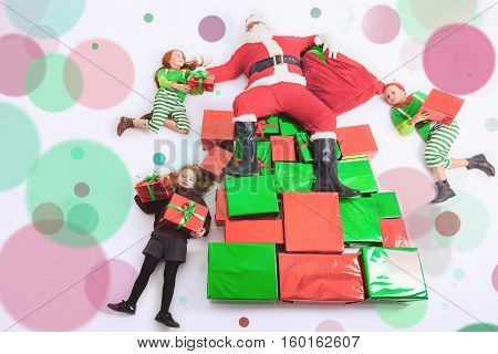 Santa's helpers are working at North Pole, elves and kids holding gift boxes. Merry Christmas. Santa sitting at many gift boxes and reading wishes list. Letters To Santa Claus. Wish list. Black Friday