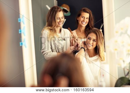 Picture showing happy woman in hair salon
