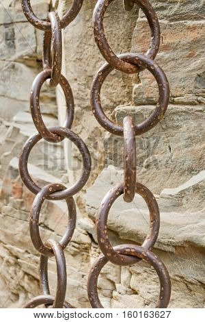Matal Chains Pairs Hanging By The Side Of A Rock Side