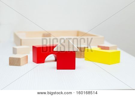 wooden toys - constructor. children's toys on a light table