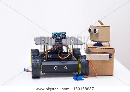 two robots are on the table on a white background