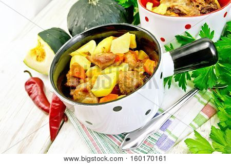 Roast Meat And Vegetables In White Pots On Board