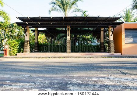 empty bus stop building stands on the roadside