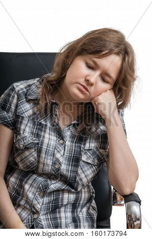 Young Sad Woman Sitting On Chair. Isolated On White Background.
