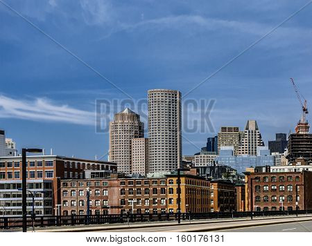 Boston downtown skyline view from waterfront area, a lotof copyspace on a sky.
