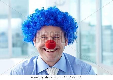 Portrait of a funny businessman imitating a clown