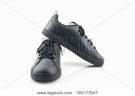 Black sneakers on a white background. Canvas Shoe.