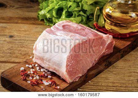 Raw Pork Loin With Salt And Herbs.