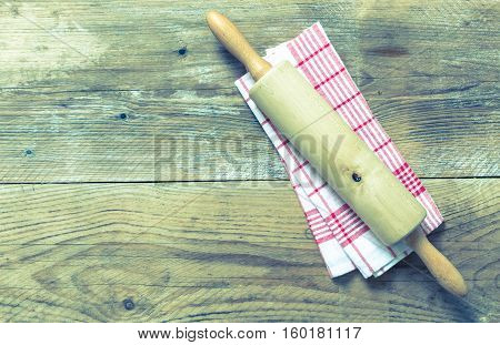 Rolling Pin And Dishcloth On Rustic Wooden Background