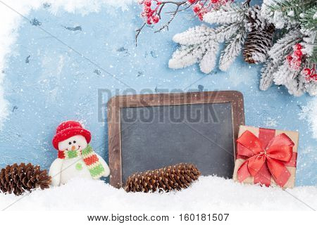 Christmas chalkboard, snowman and fir tree. View with copy space for your text