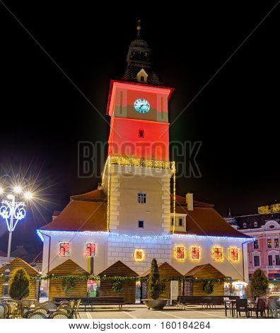 Brasov Council House decorated for Christmas at night, Brasov, Romania