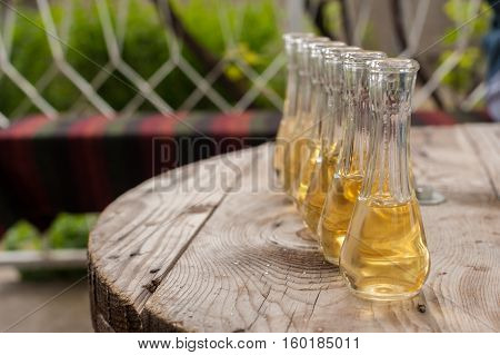 Plum Brandy In Shot Glasses On Wooden Table