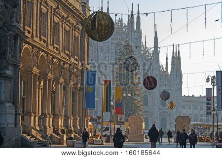 First impressive look at famous Milan Cathedral (Duomo di Milano) on piazza in Milan Italy on December 30, 2013