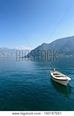 Single boat at smooth sea surface near Perast, Kotor Bay, Montenegro