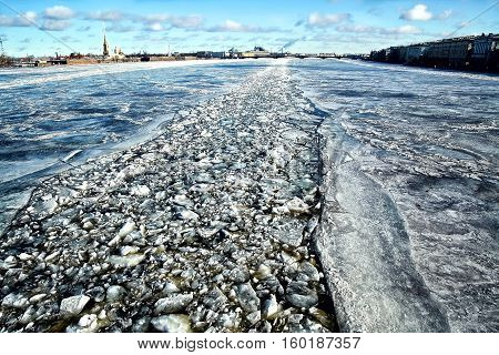 Frozen river Neva in St. Petersburg, Russia and trace of crushed ice after the riverboat made its way through frozen river.
