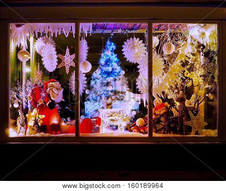 Christmas shop window with tree and festive decorations
