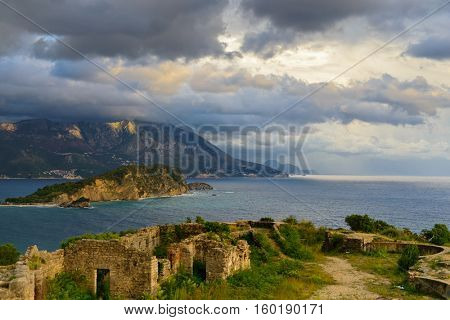 View to Budva bay from ruins of medieval fortress Tvrdava Mogren at the shore of Adriatic sea. Historic attractions of Budva, Montenegro