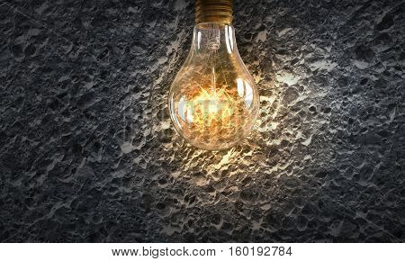 Electric bulb on texture . Mixed media