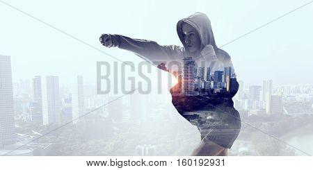 Young boxer woman outdoor . Mixed media