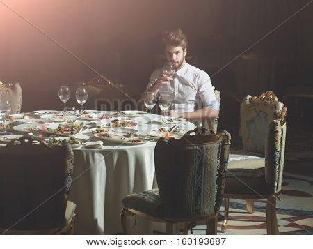 Handsome Man Drinks Wine