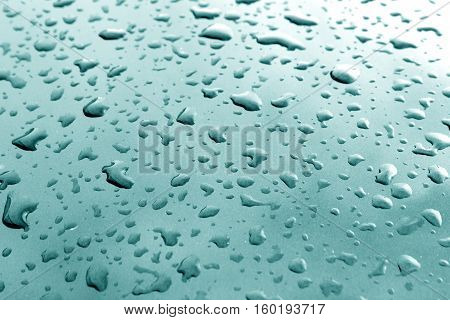 Rain Drops On Cyan Color Metal Surface With Blur Effect