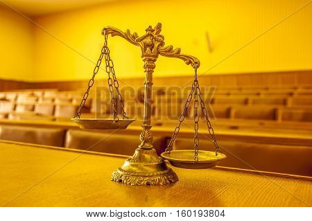 Scales of justice in the empty courtroom law and justice concept focus on the scales