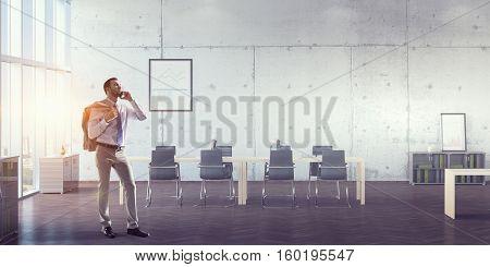 Businessman making calls . Mixed media