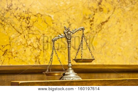 Symbol of law and justice in the empty courtroom law and justice concept focus on the scales