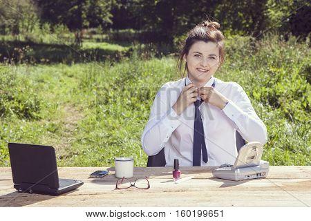 Business Woman Ties Necktie
