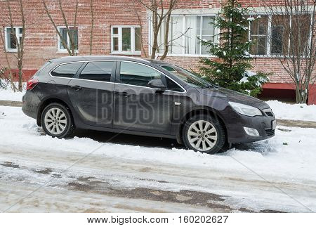 Smolensk, Russia - November 13, 2016: Opel Astra (Vauxhall Astra in USA) parked in winter near the house.