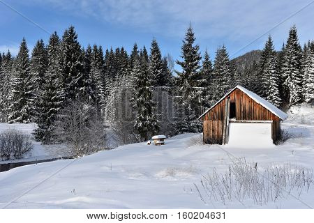 Winter Landscape With A Small Wooden Hut