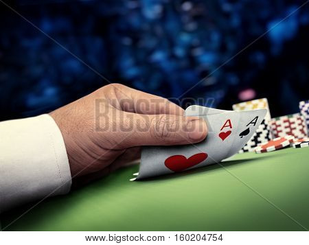 poker player in online casino during tournament lifting cards