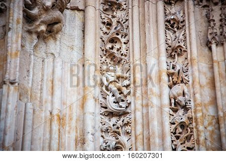 SALAMANCA SPAIN - SEPTEMBER 24 2013: The famous astronaut carved in stone in the Salamanca Cathedral facade. The sculpture was added during renovations in 1992