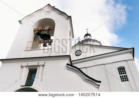 The white Russian Belarusian Orthodox Christian Church of Our Saviour and Transfiguration with bells in the Bell tower the angle of view Rakov Belarus