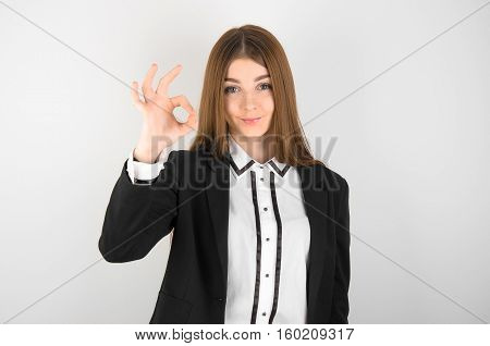 Business And Advertising Theme: Beautiful Young Girl With Freckles On Her Face In A Black Jacket And