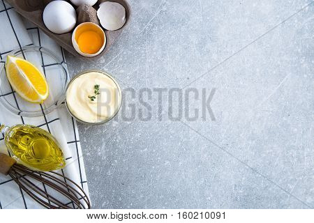 Fresh Homemade White Sauce Mayonnaise And Ingredients Eggs, Lemon Olive Oil On Stone Background. Cop