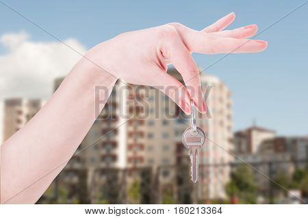 Woman Hand Is Handing A House Key