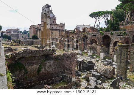 The Roman Forum is a rectangular forum surrounded by the ruins of several important ancient government buildings at the center of the city of Rome.