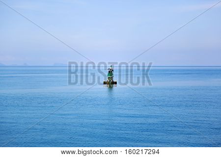 View on the ocean with beacon - seamark in the middle of the frame.