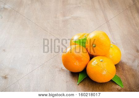 Fresh Organic Tangerines on a Wooden Background. Delicious and Beautiful Tangerines. Selective Focus.