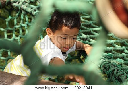 Japanese boy playing at field athletic (first grade at elementary school)