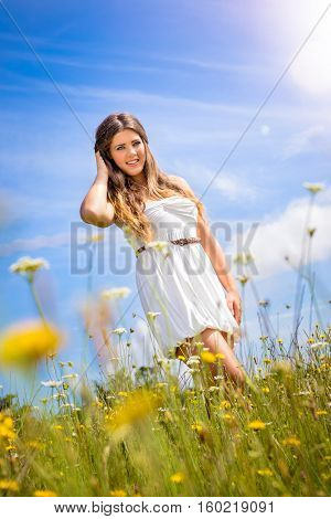 Beautiful woman in field of flowers