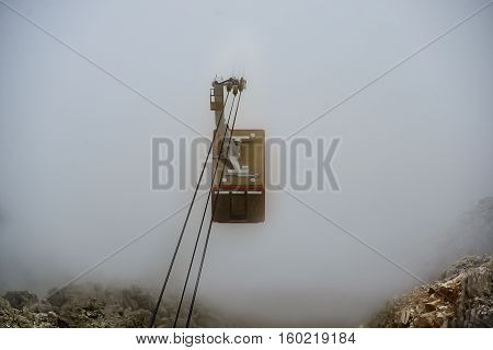 the funicular ascends from the white clouds