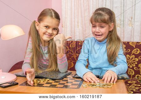 Two Girls At The Table Collected Montki One Cries, The Other Laughs At It