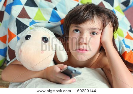 Boy In Bed Watch Tv With Remote Control