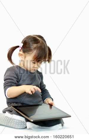Japanese girl using a tablet PC (2 years old)